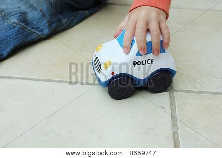 Boy Playing With Police Toy Car