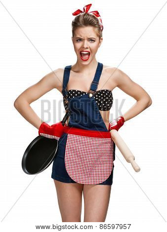 Angry Housewife With Battledore And Black Frying Pan / Young Beautiful American Pin-up Girl Isolated