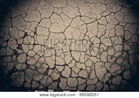 Crack Dry Soil Ground Background In Grunge Color