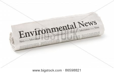 Rolled Newspaper With The Headline Environmental News