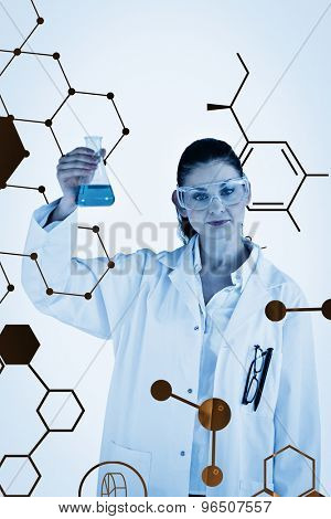 Science graphic against darkhaired woman holding a blue flask