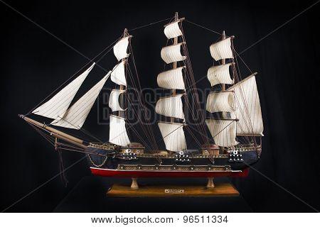 Highly detailed XVIII century frigate model isolated over black background