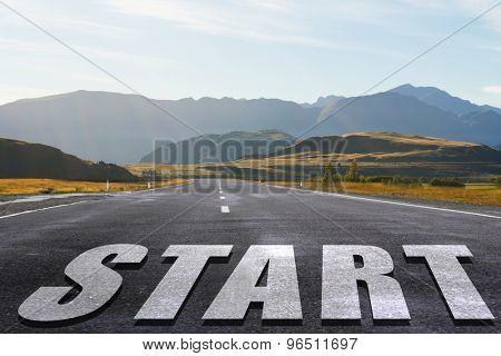 Start word as motivation writen on asphalt road