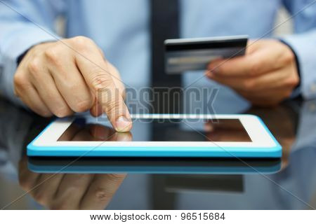Businessman Is Buying Goods  On Tablet Computer With Credit Card