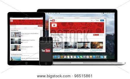Youtube App Logo On The Iphone Ipad Displays And Desktop Version Of Youtube On Macbook Pro Screen