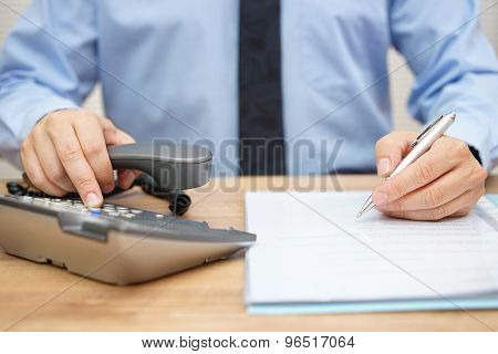 Businessman Needs Assistance For Legal Document And Calling His Adviser