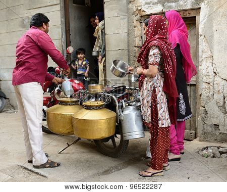 Street Sellers Of Milk In India