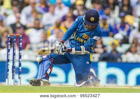 LONDON, ENGLAND - June 17 2013: Sri Lanka's Mahela Jayawardene attempts a reverse sweep during the ICC Champions Trophy international cricket match between Sri Lanka and Australia.