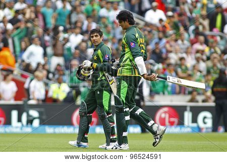 LONDON, ENGLAND - June 07 2013: Pakistan's Misbah-ul-Haq and Mohammad Irfan walk off the pitch at the end of the Pakistan innings during the ICC Champions Trophy match between Pakistan and West Indies