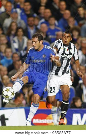LONDON, ENGLAND. September 19 2012 Chelsea's English midfielder Frank Lampard and Juventus's midfielder Arturo Vidal  during the UEFA Champions League football match between Chelsea and Juventus