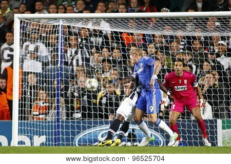 LONDON, ENGLAND. September 19 2012  Chelsea's Fernando Torres heads the ball  as Juventus's Gianluigi Buffon watches on during the UEFA Champions League football match between Chelsea and Juventus