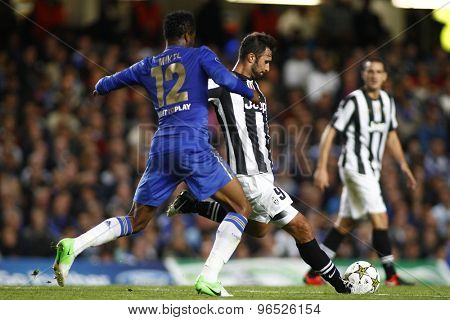LONDON, ENGLAND. September 19 2012 Chelsea's Nigerian midfielder Mikel and Juventus's Montenegro forward Mirko Vucinic during the UEFA Champions League football match between Chelsea and Juventus