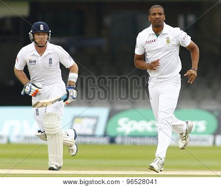 LONDON, ENGLAND. AUGUST 20 2012 England's Ian Bell and South Africa's Vernon Philander during the third Investec cricket  test match between England and South Africa, at Lords Cricket Ground