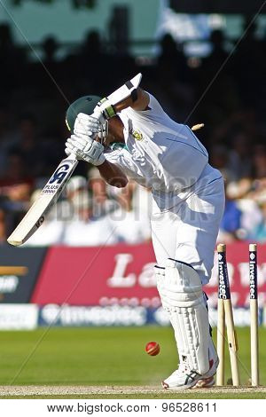 LONDON, ENGLAND. AUGUST 19 2012 South Africa's Imran Tahir is bowled by England's James Anderson during the third Investec cricket  test match between England and South Africa, at Lords Cricket Ground