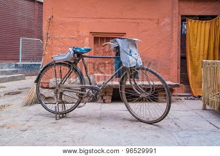 VARANASI, INDIA - 21 FEBRUARY 2015: Newspaperman's bicycle in street with fresh newspapers.