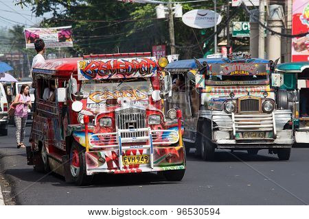 Jeepneys Passing, Filipino Inexpensive Bus Service.