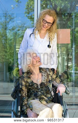 Happy Heath Care Assistant And Elderly Patient