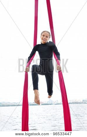 Cheerful Child Training On Aerial Silks Outdoor