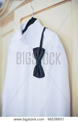 Wedding bright white shirt and black bow. Formal groom shirt with black bow-tie