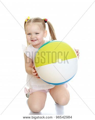 Sweet girl with a ball