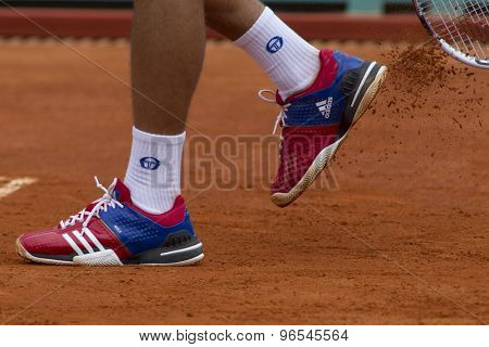 MONTE CARLO, MONACO. APRIL 18 2012 Novak Djokovic (SRB) clears clay off his training shoes during the second round match with Andreas Seppi (ITA) at the ATP Monte Carlo Masters