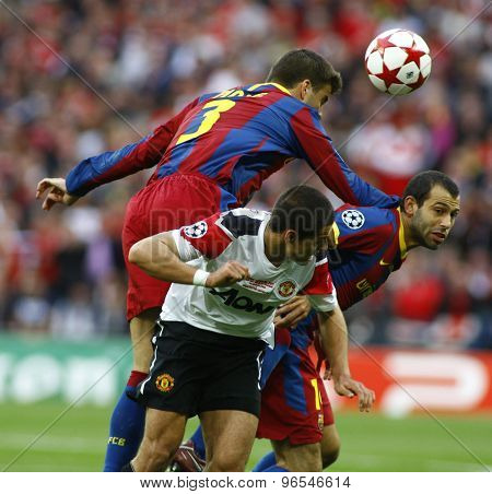 LONDON, ENGLAND. May 28 2011: Barcelona's Gerard Pique,  Javier Mascherano and Javier Hernndez during the 2011UEFA Champions League final between Manchester United and FC Barcelona, at Wembley Stadium