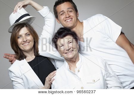Happy 3 generations family in white cloths.
