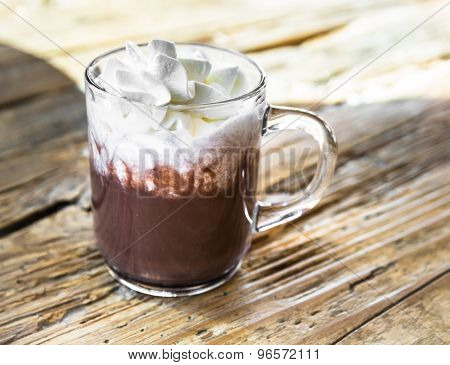 Chocolate Drink With Whipped Cream In Transparent Cup On Wooden Table