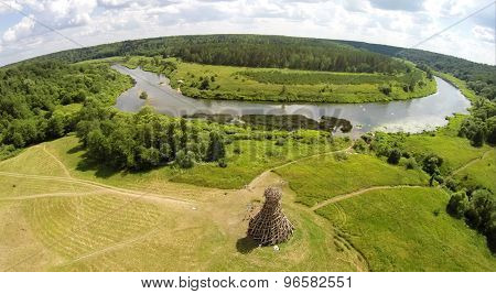 RUSSIA, NICOLA-LENIVETS - JUL 6, 2014: River shore with art object Lighthouse On Ugra in Wonderland Park during 9th Festival of landscape objects Archstoyanie. Photo with noise from action camera.