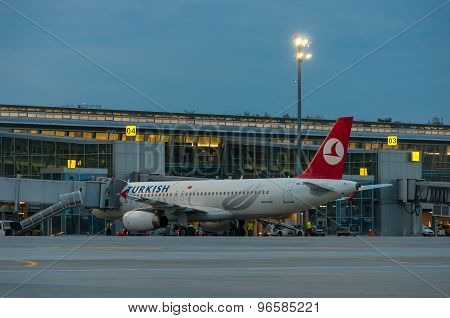 KIEV, UKRAINE - JULY 10, 2015: Turkish airlines aircraft stay near terminal of airport and ready for