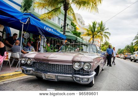 Classic retro car parked along ocean dr. street in south Miami