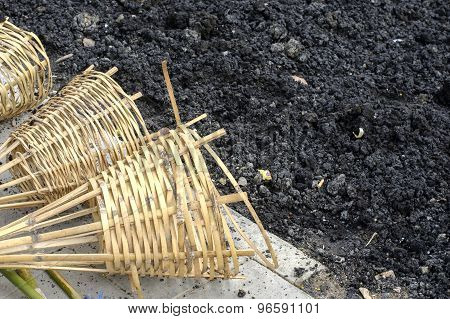 Bamboo Wickerwork Basket On Floor Near Black Soil