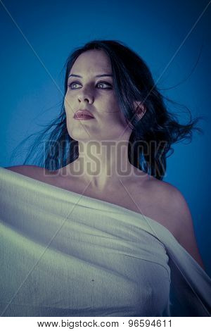 Greek muse with white veil, beautiful brunette woman with long cloth