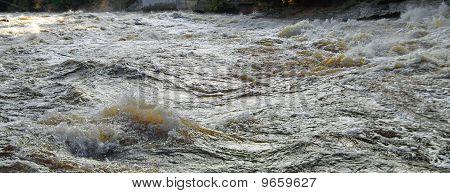 Tumultuous Brown Canadian River