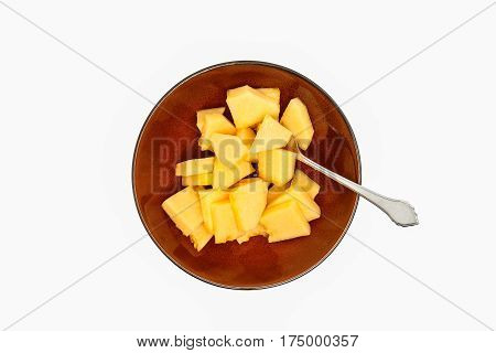 Top shot of a bowl of sliced cantaloupe.