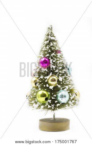 Small plastic xmas tree on white background