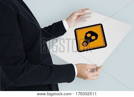 Studio Shoot Holding Banner with Radioactivity Protection Mask Sign
