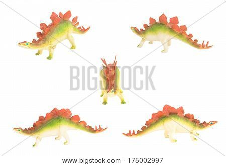 toy stegosaurus dinosaurs isolated on white facing different directions