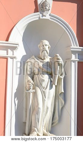 Statue of Apostle Paul with a sword. Fragment of Church of Saints Cyril and Methodius at sunny day in St.Petersburg Russia.