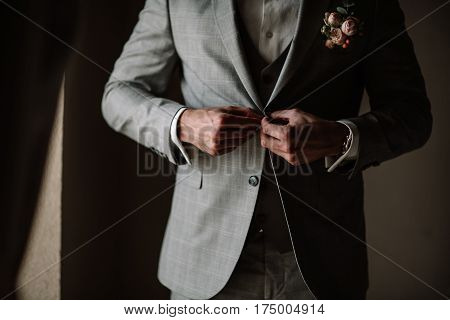 Businessman Or Groom In White Shirt With Minty Tie Fasten Button Of His Blue Tweed Jacket