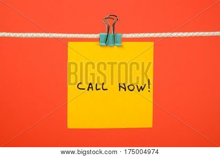 Yellow Paper Note On Clothesline With Text Call Now!