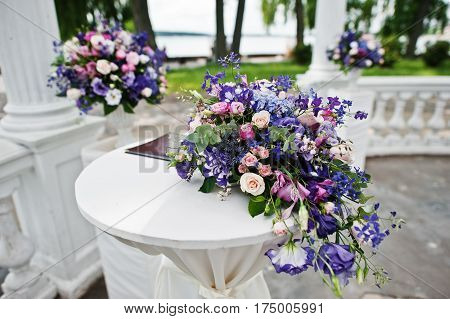 Decoration Of Wedding Arch With Registration Table For Newlyweds With Violet And Purple Flowers.