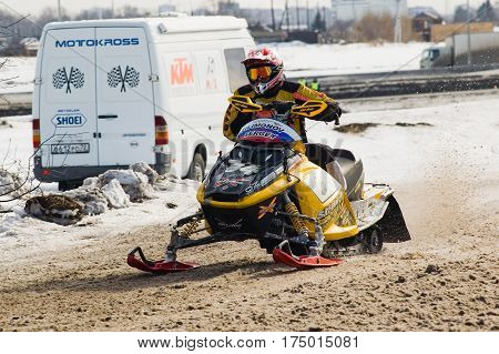 Tyumen Russia - March 08. 2008: IV stage of personal-team Championship of Ural Federal district in over-snow cross-country. Snowmobile rider on sport track