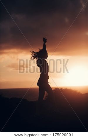 Black Silhouette Of Pretty Girl At Idyllic Sunset