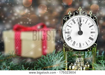 Christmas countdown: Midnight clock and Christmas gift in background