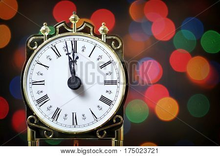 New Year countdown: Vintage clock showing midnight