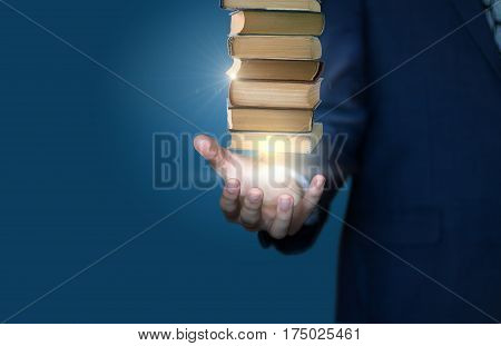 Businessman Show Stack Of Books .