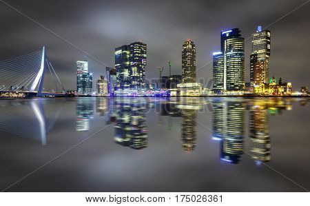 Amazing Night Reflection Of Erasmus Bridge And Several Skyscrapers In Rotterdam, Holland.