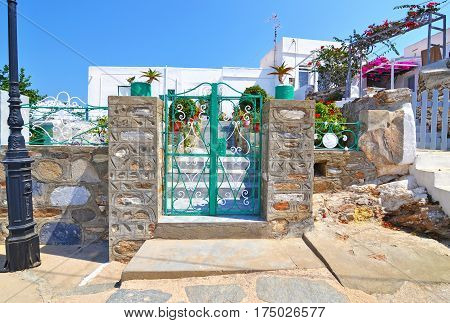 traditional houses with bougainvilleas at Sinfos island Greece - Cyclades architecture