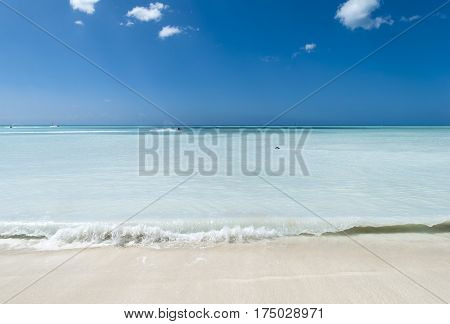 The unusual color sea on Antigua island beach (Antigua & Barbuda).